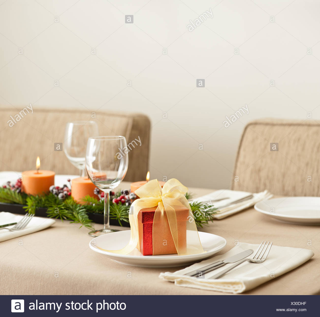 Christmas Dinner Table Setting With Orange Candles Stock Photo