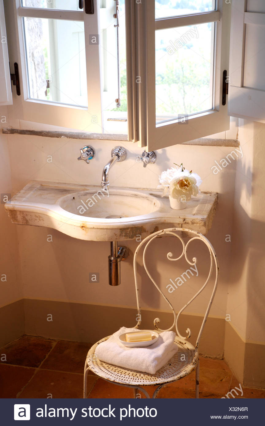Open windows above small wall mounted basin in Italian country ... on bathroom window above vanity, bathroom window above shower, bathroom window above door, bathroom recessed lighting, kitchen above sink,