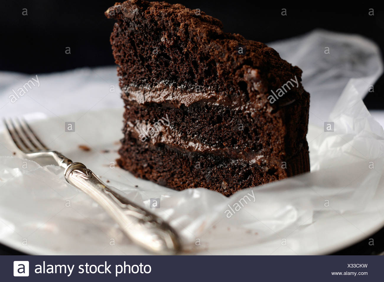 Chocolate fudge cake with silver fork - Stock Image