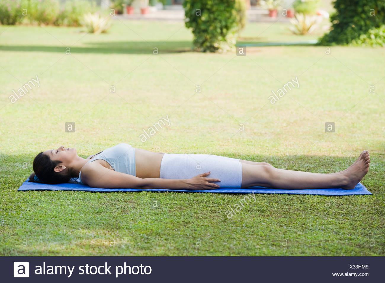woman doing savasana corpse pose stock photo 277289609 alamy