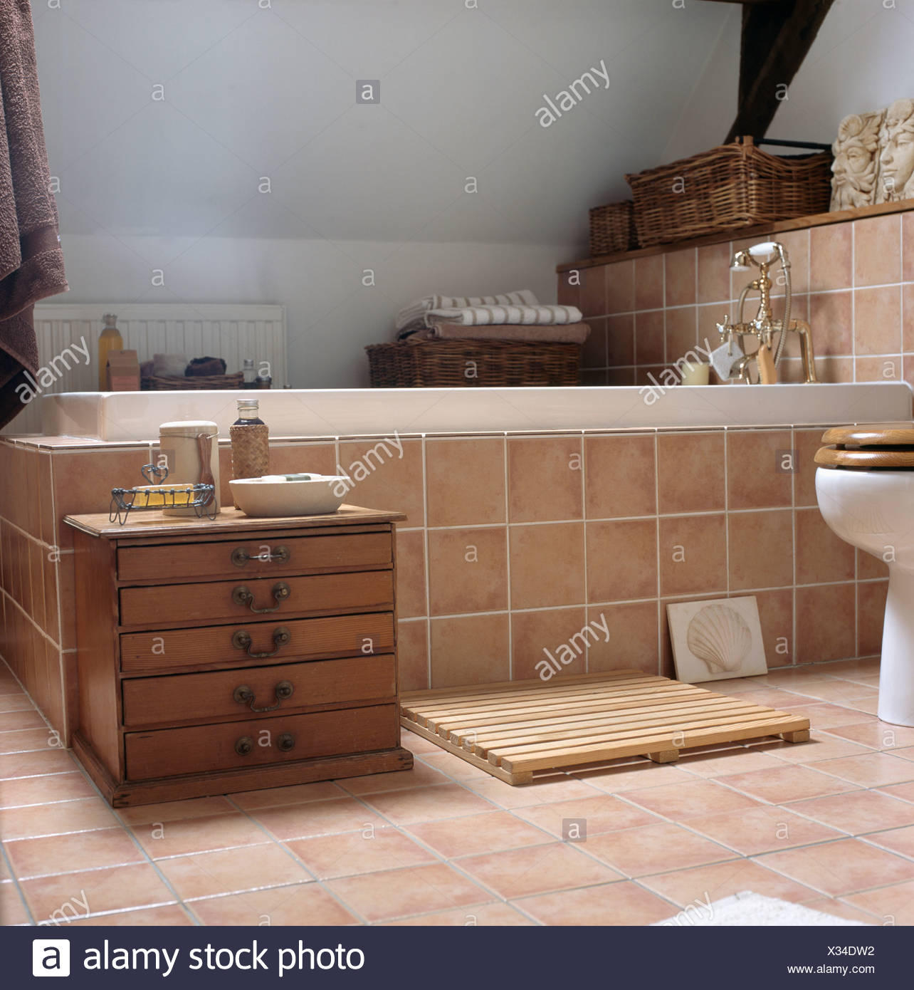 beige tiled bath surround and floor in white attic bathroom with