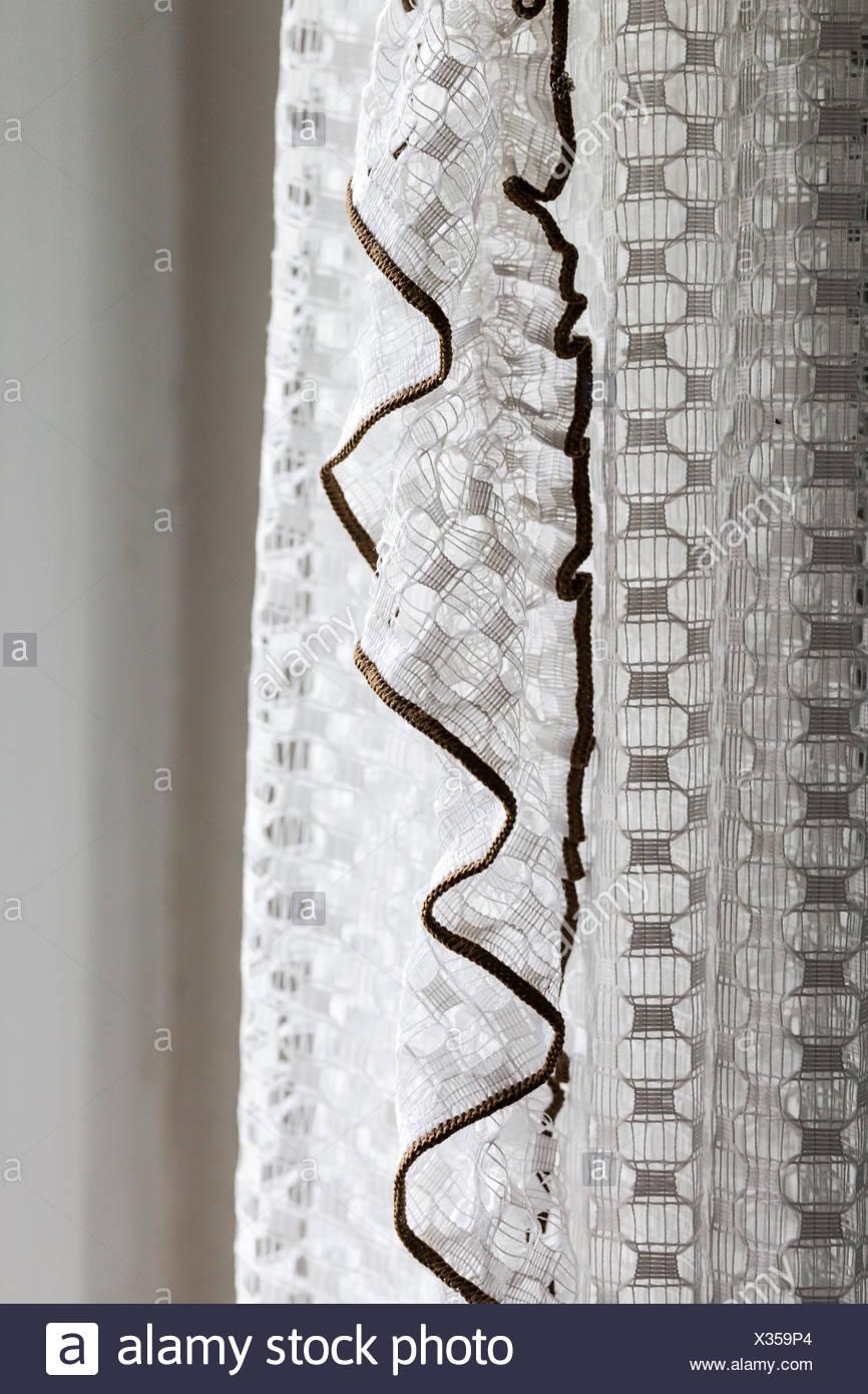 nostalgic white net curtain decoration - Stock Image