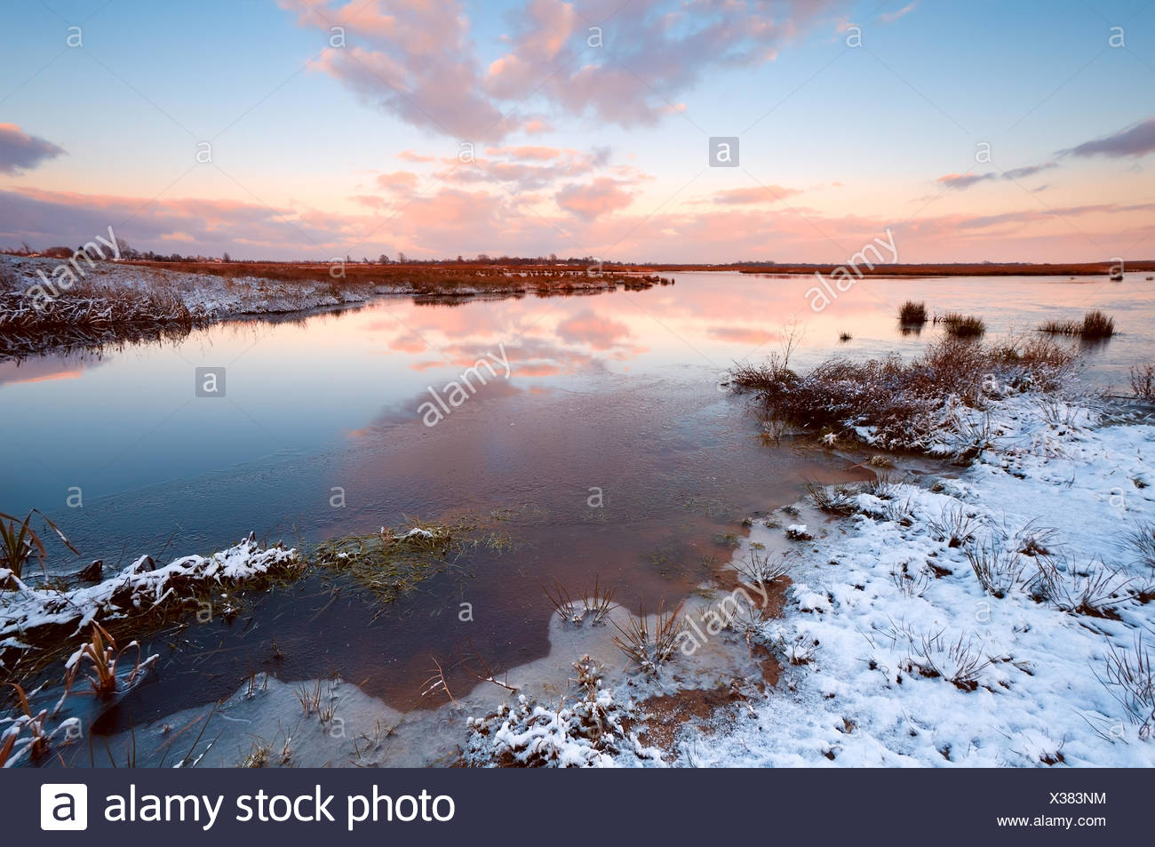 sunrsie over river in winter - Stock Image