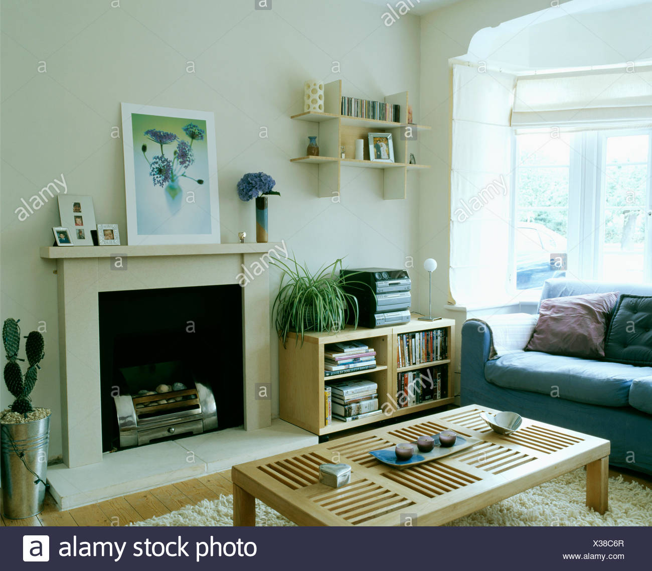 Small Wall Shelves Above Low Pale Wood Shelf Unit With Music Centre In  Modern White Living Room With Simple Coffee Table