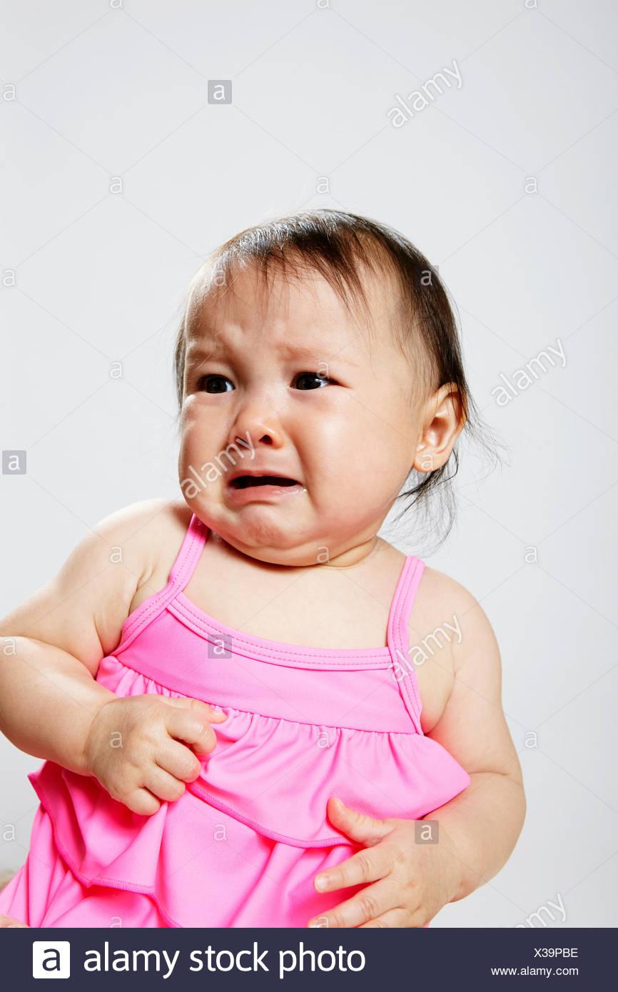 Portrait of baby girl, crying - Stock Image