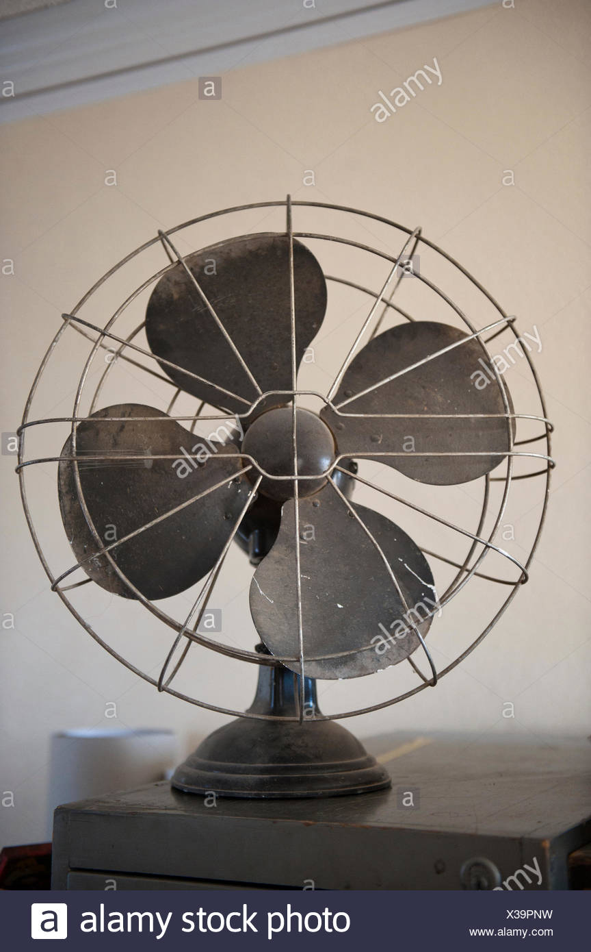 An antique fan. - Stock Image