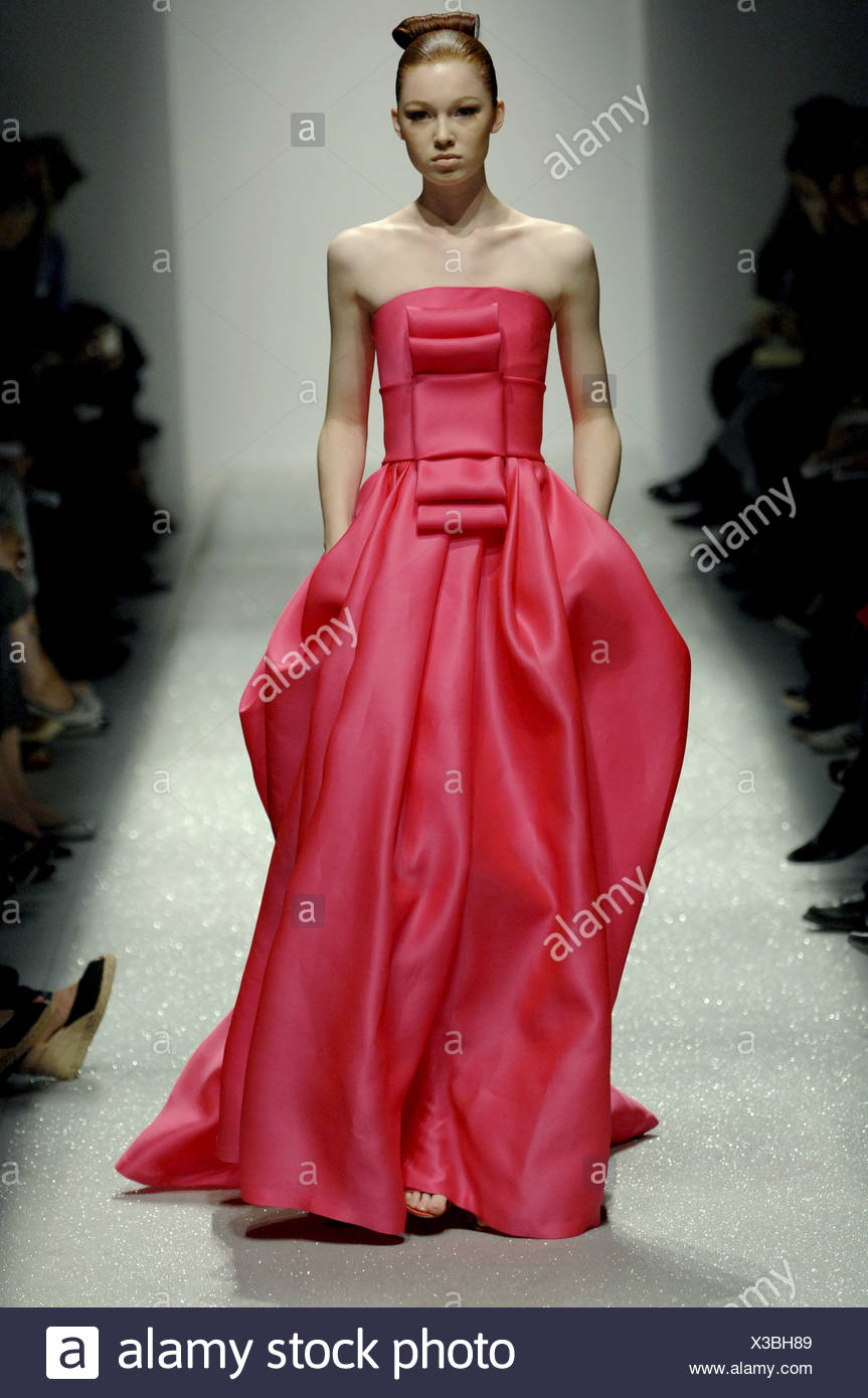 932fd725fb Martin Grant Ready to Wear Spring Summer Tight updo bun hair and deep pink  silk strapless floor length gown front bow detail on