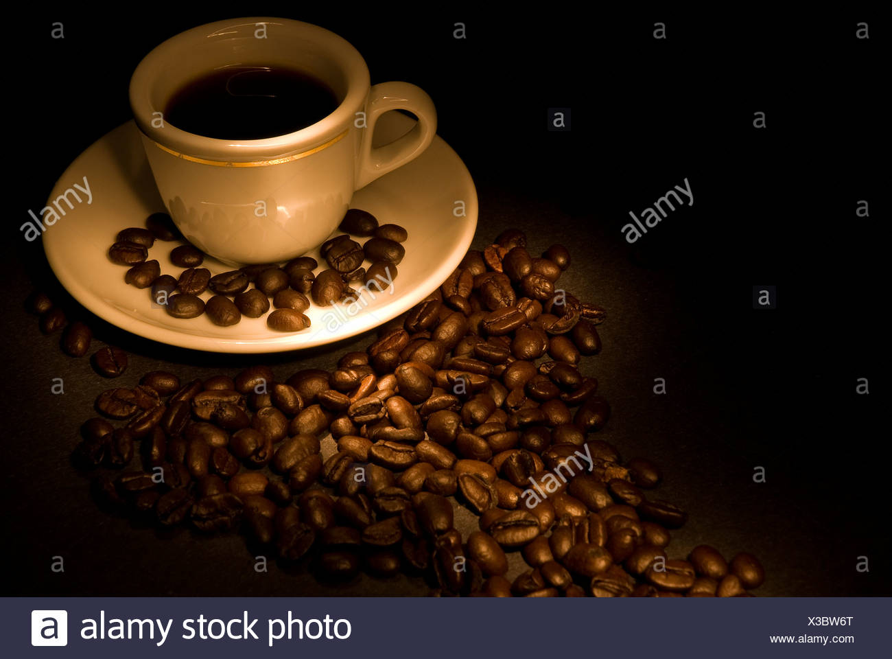 Calgary, Alberta, Canada; Coffee beans and fresh cup of coffee - Stock Image