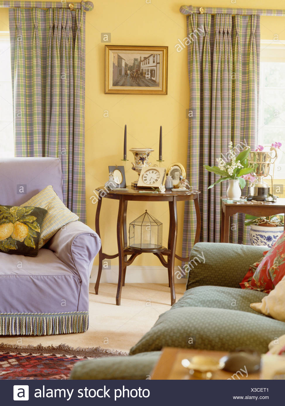 Green Sofa And Mauve Armchair In Pastel Yellow Living Room With Mauve And  Yellow Checked Curtains