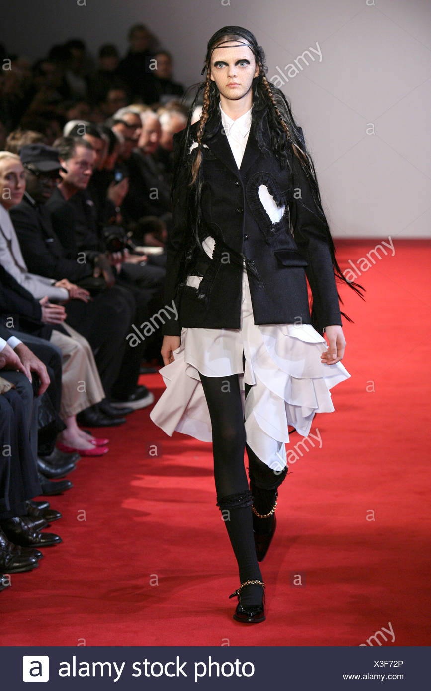 7218fa6e4492 Comme Des Garcons Paris Ready to Wear Autumn Winter Model wearing a black  riding style jacket hearts cut out and a white shirt