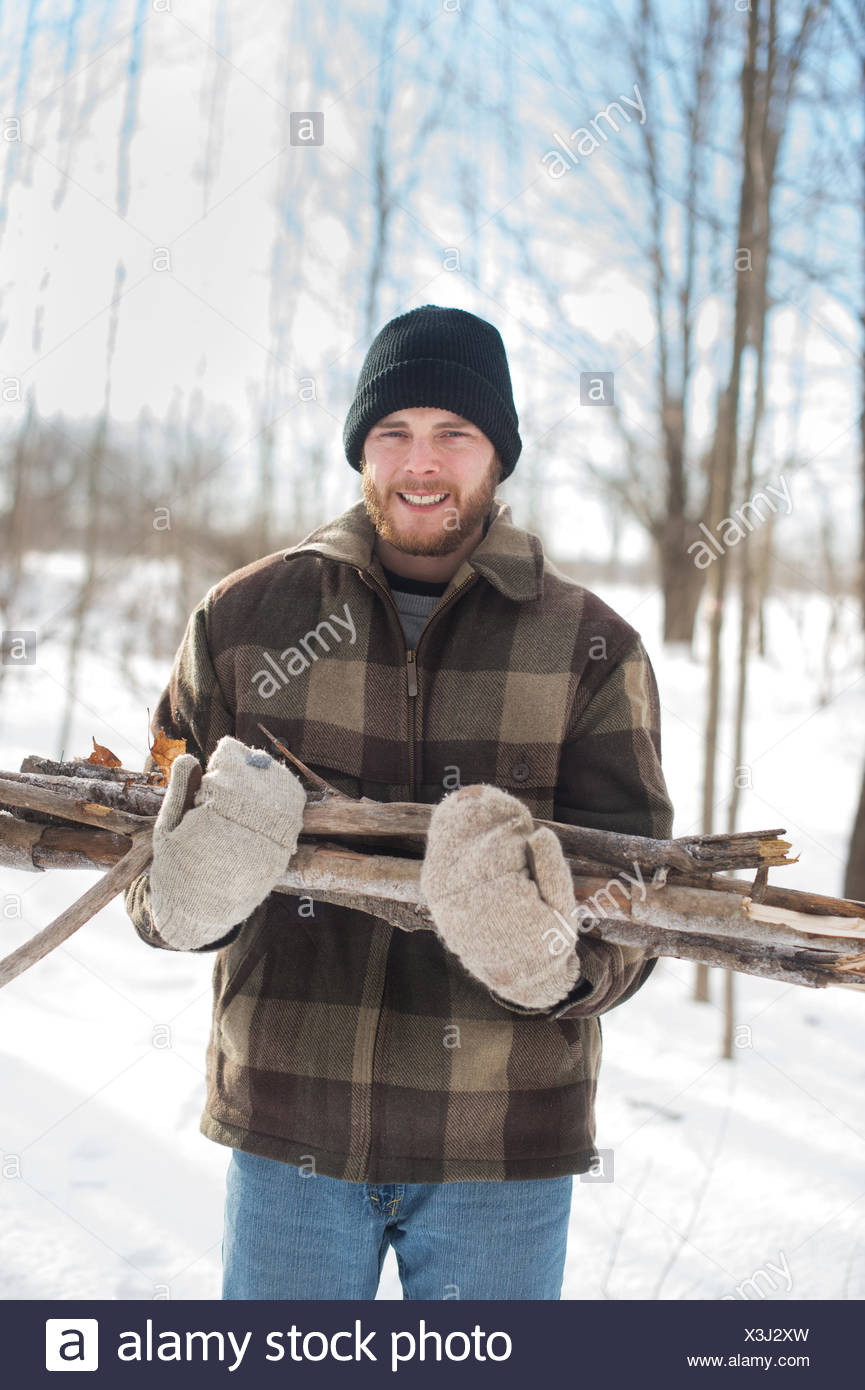 Man gathering wood in forest, Young's Point, Ontario, Canada - Stock Image