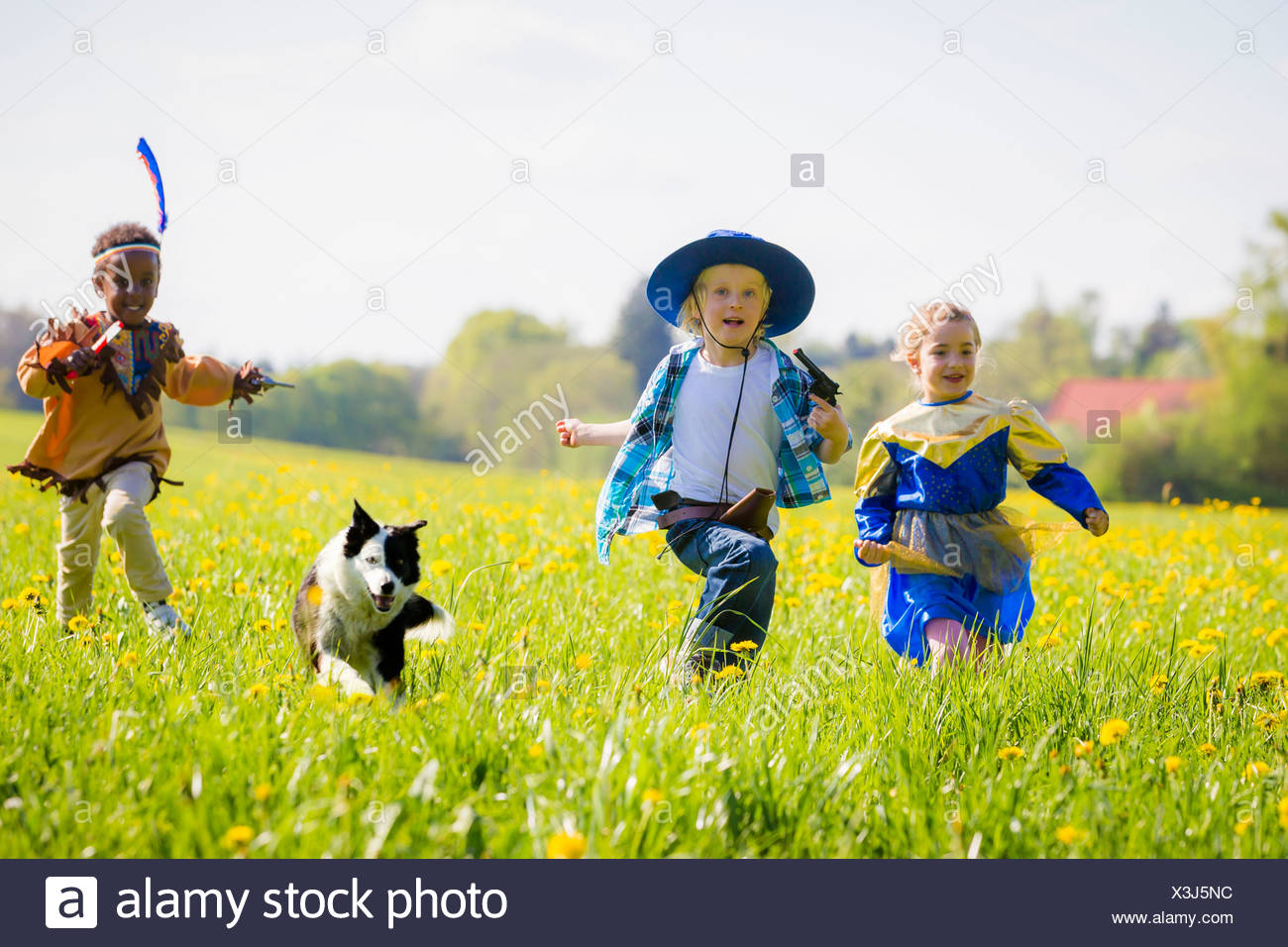 Children playing dress up outdoors - Stock Image