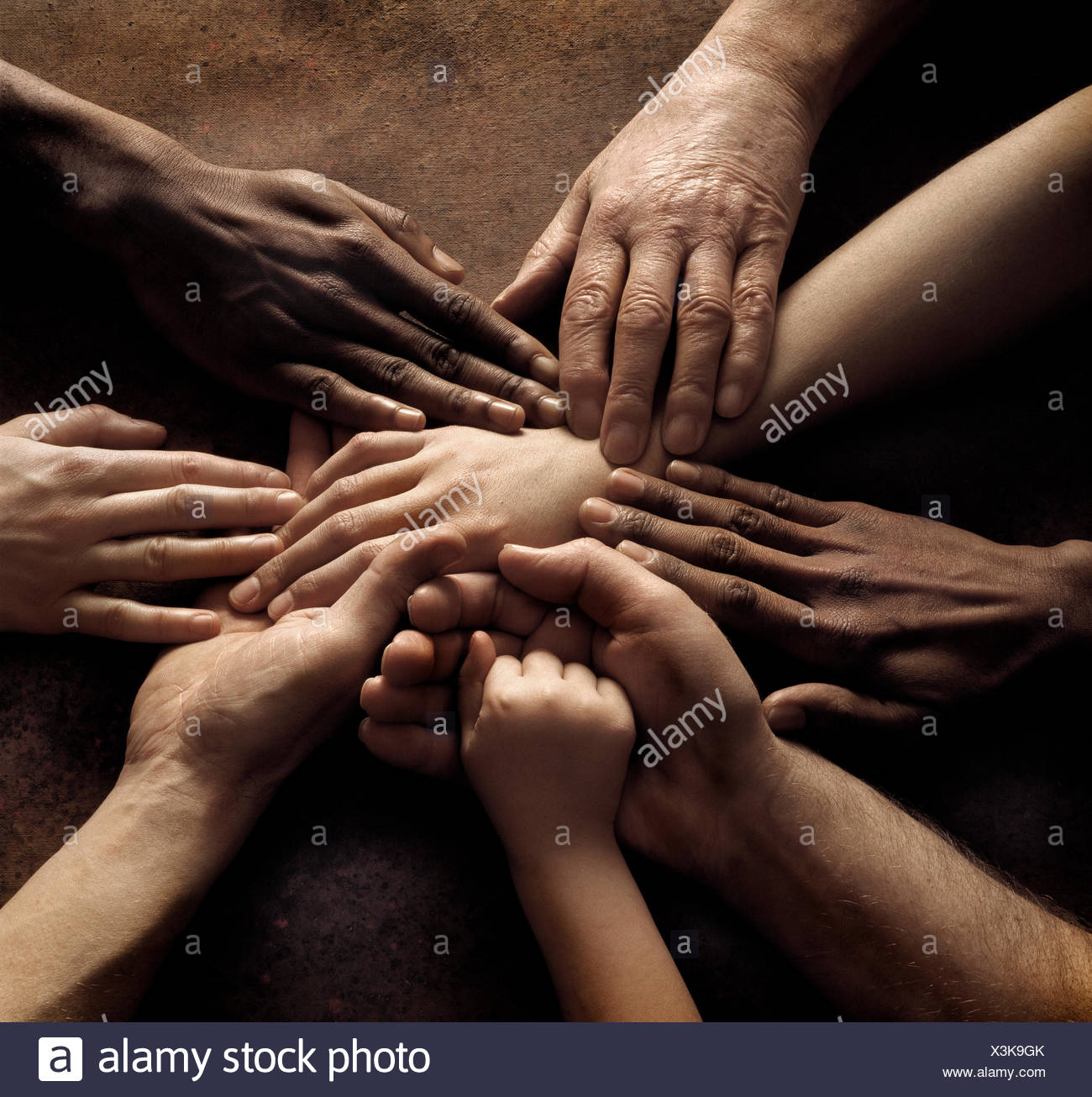 Close-up of people´s hands holding together - Stock Image