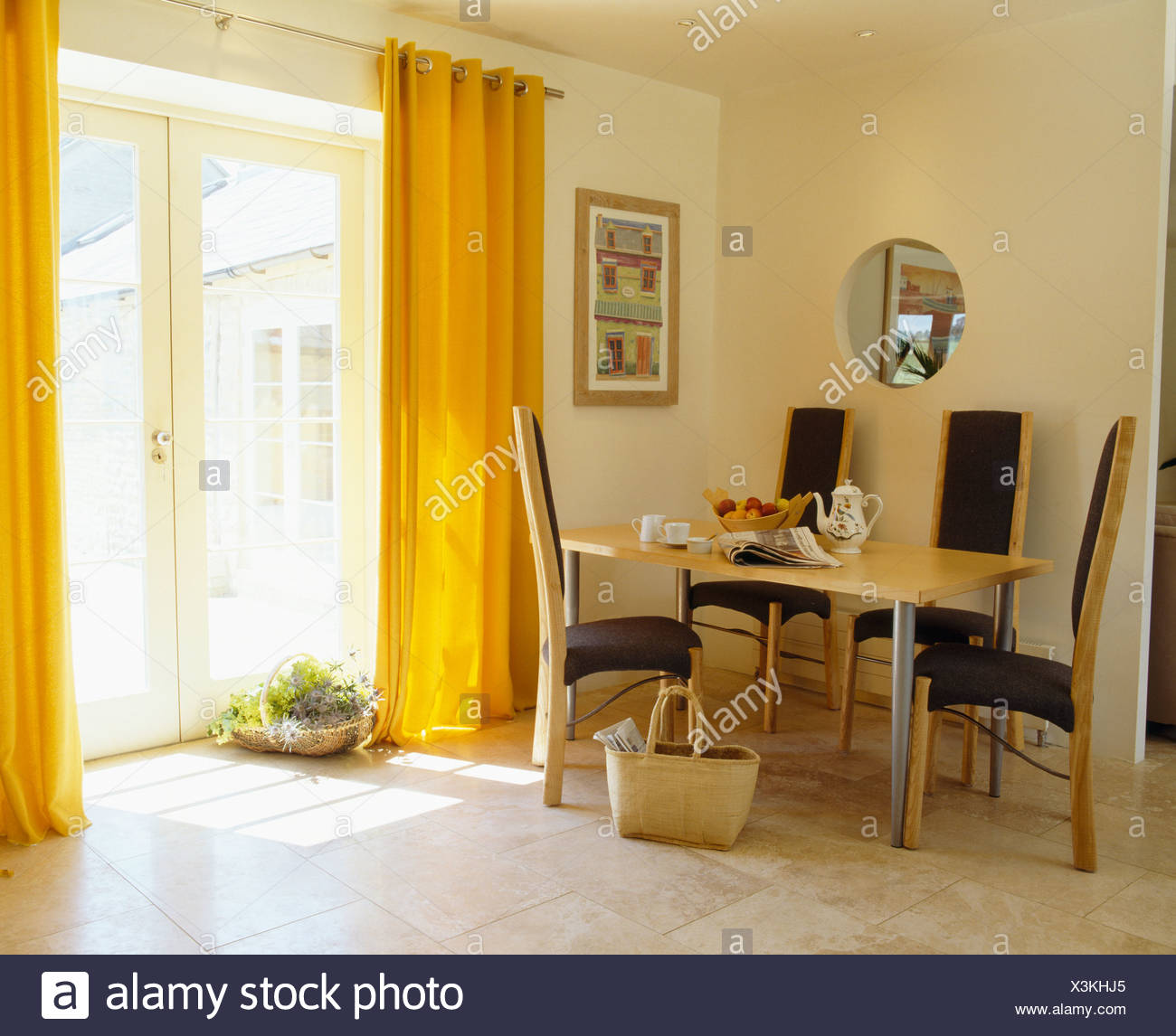 Yellow Curtains And Limestone Flooring In Modern Dining Room With Tall Back Chairs At Simple Table