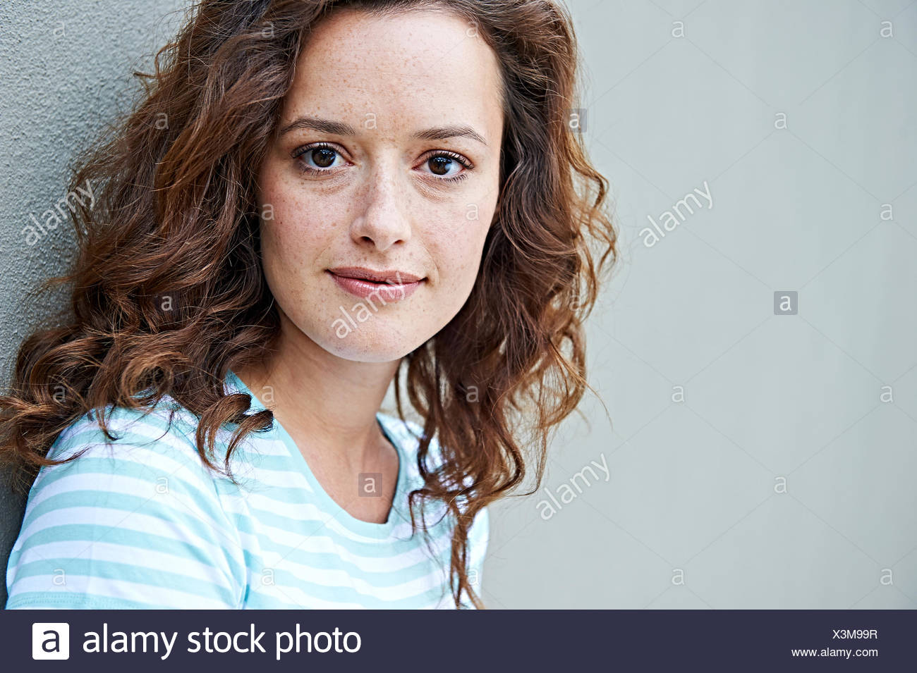 Close up of woman with freckles - Stock Image