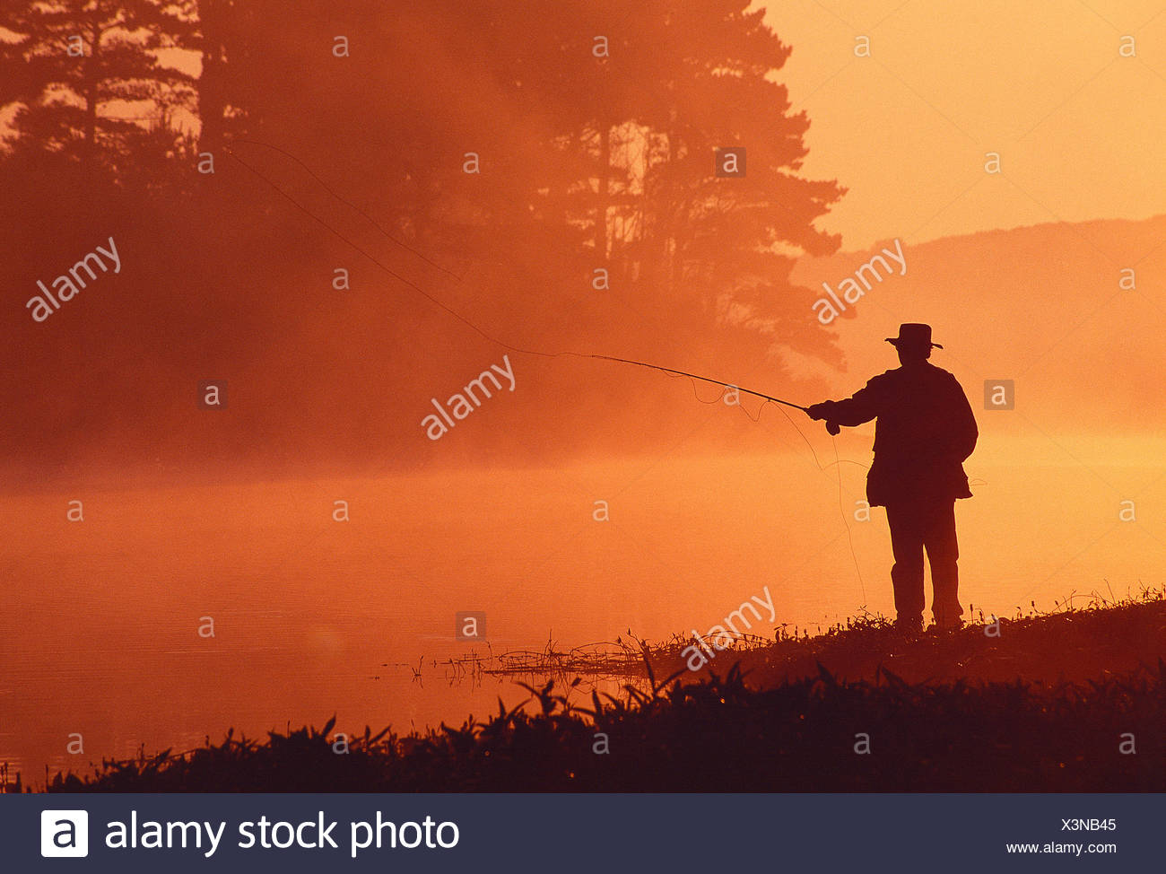 Sport. Angling. Man fly fishing. Guernsey. Channel Islands. - Stock Image