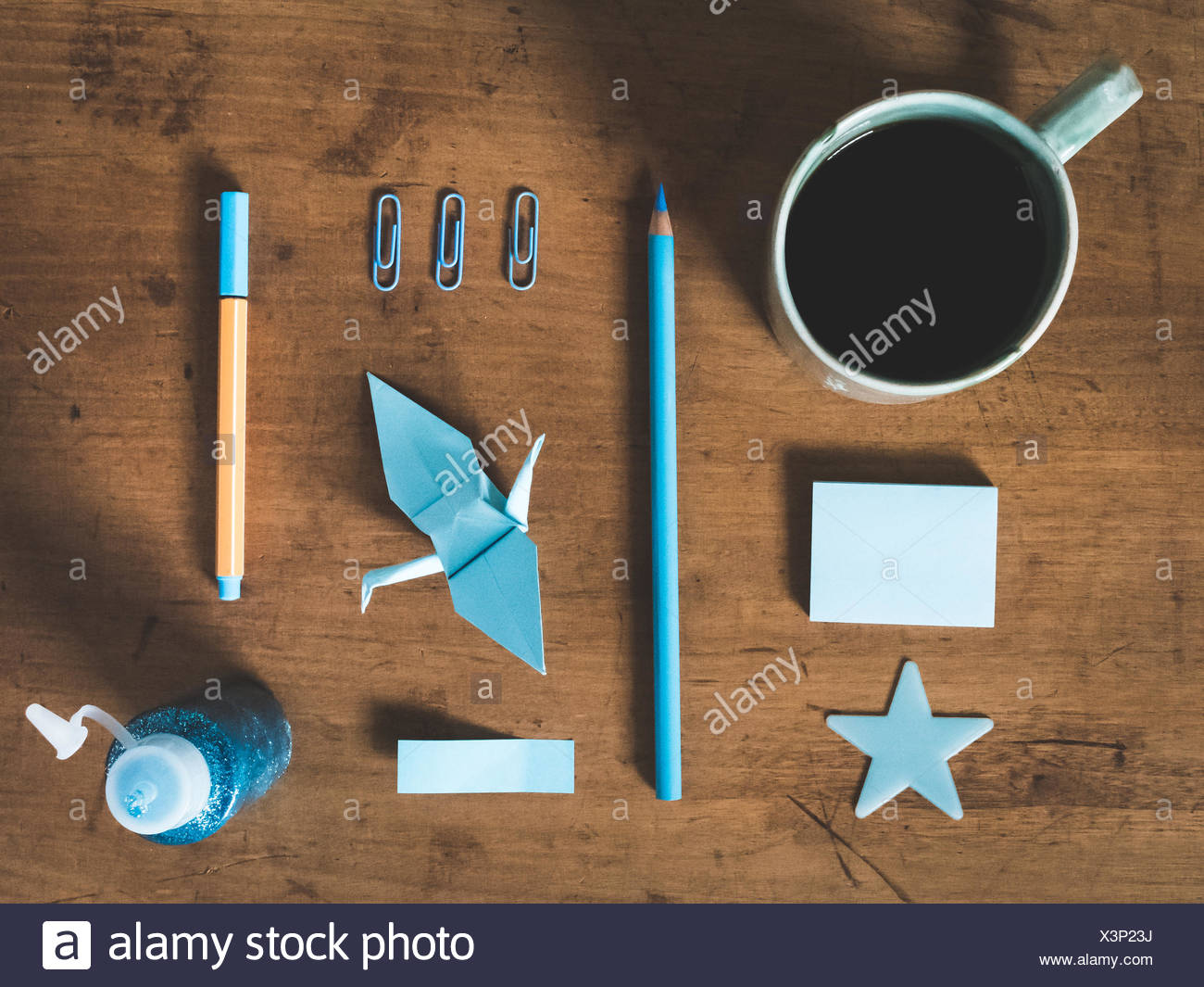 Directly Above Shot Of Equipments And Coffee Cup On Table - Stock Image