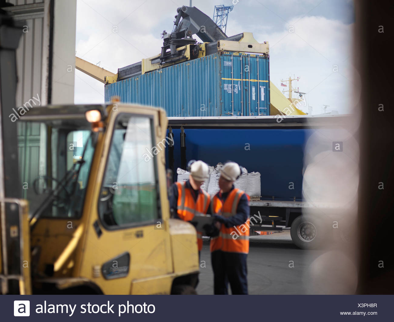 Port Workers With Shipping Container - Stock Image