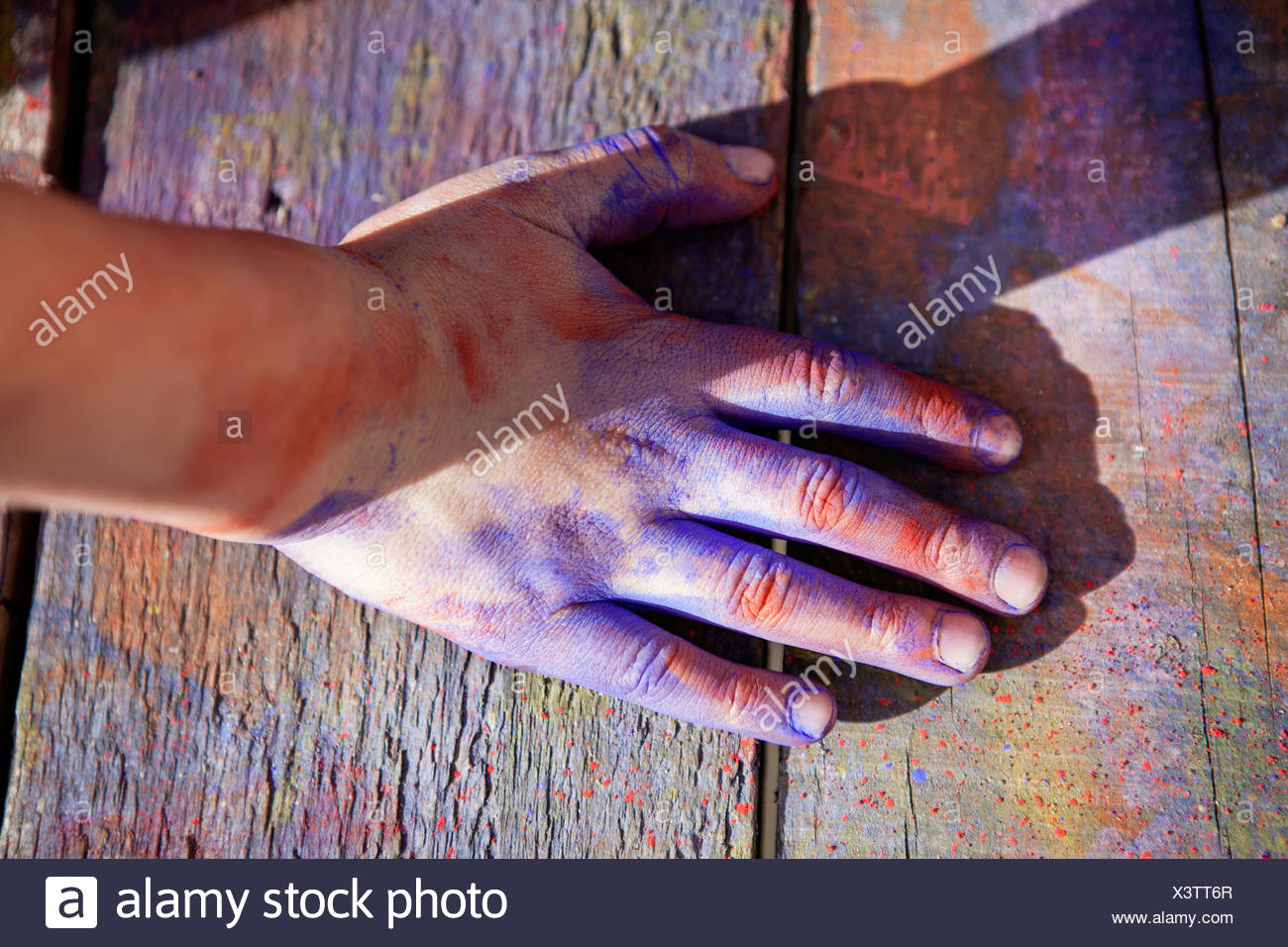 Germany, North Rhine Westphalia, Cologne, Human hand covered with colour, close up - Stock Image