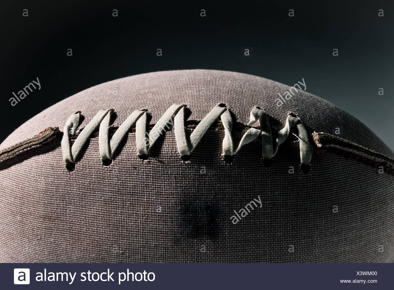 Close up of stitching on american football - Stock Image