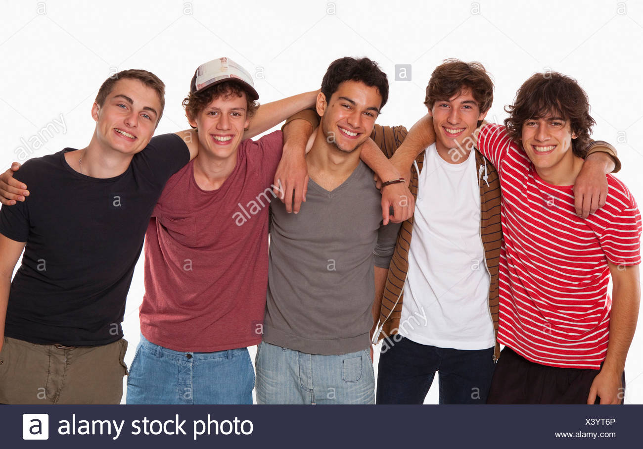 Teenagers five friendship smiling fun arm in arm - Stock Image