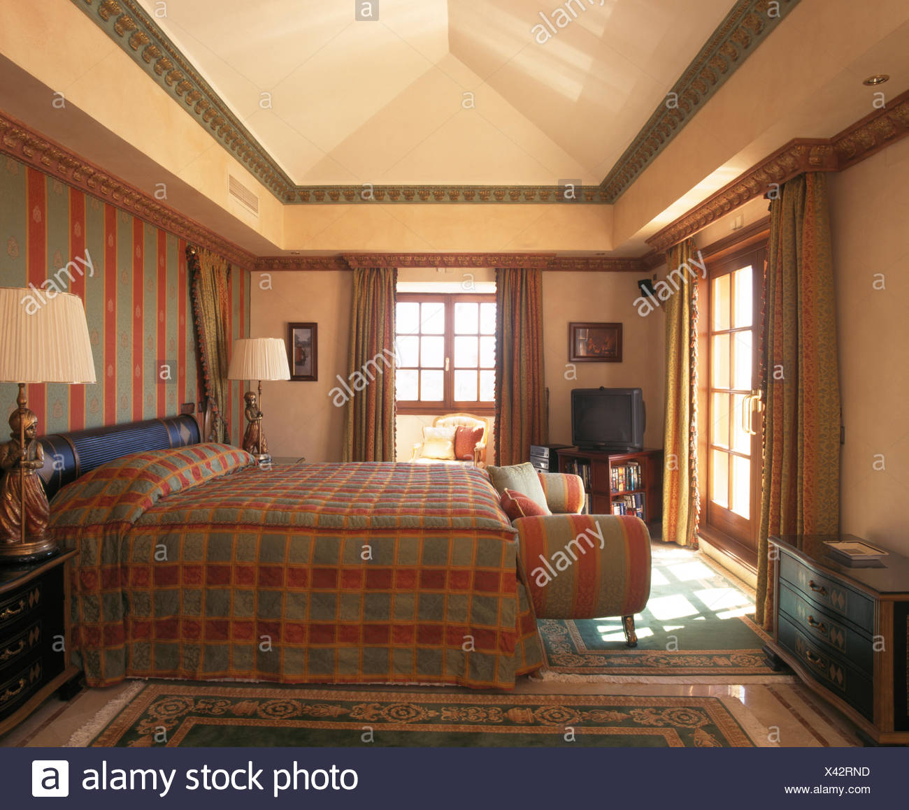 Checked Quilt On Bed In Spanish Bedroom With Co Ordinating Wallpaper