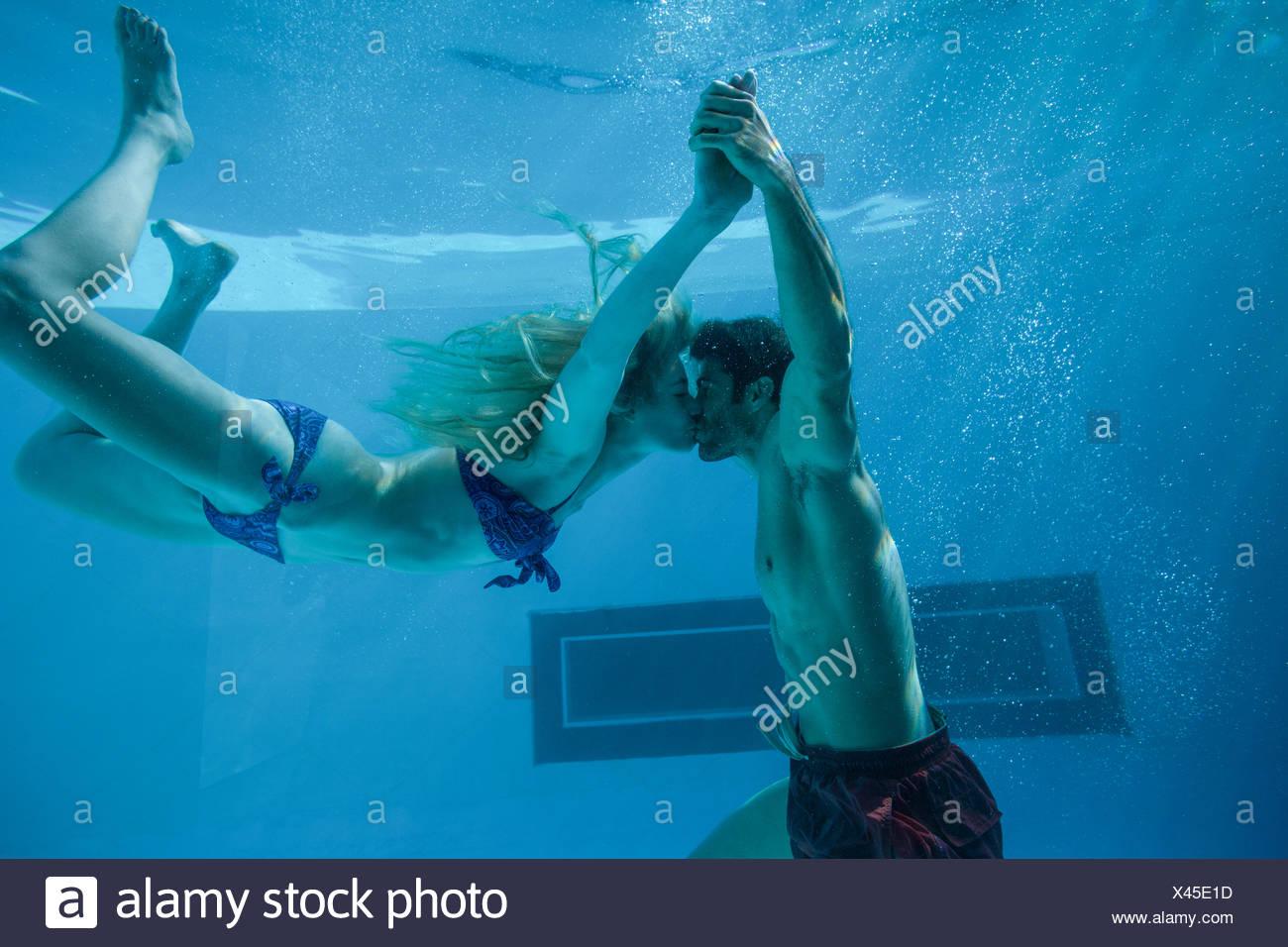 Cute Couple Swimming Underwater In Stock Photos Cute Couple Swimming Underwater In Stock