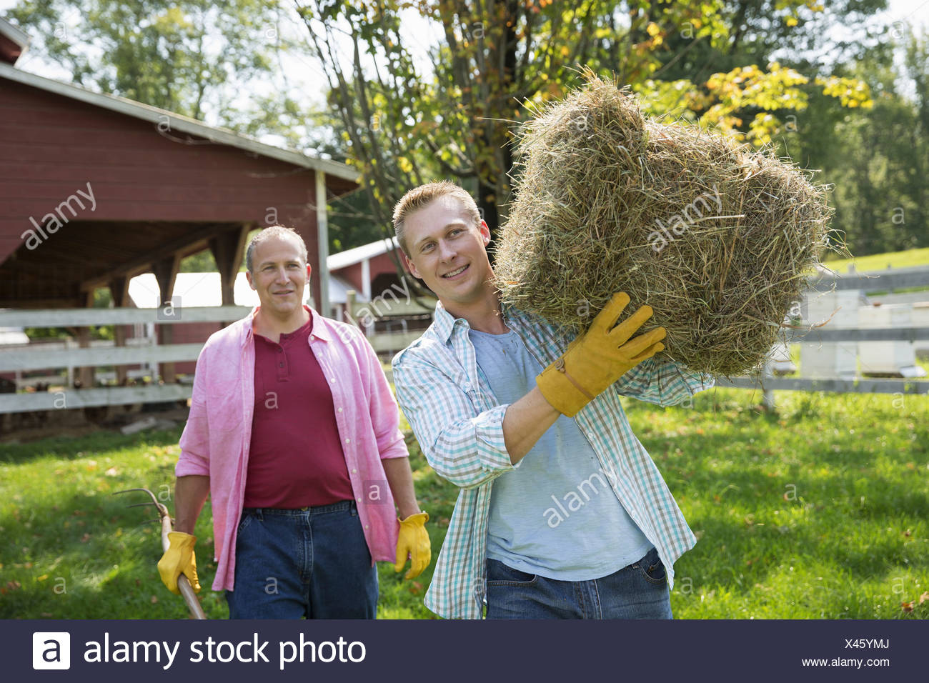 A family summer garing at a farm. A shared meal a homecoming. - Stock Image