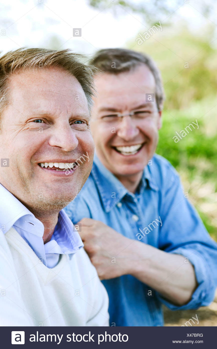 Close-up of cheerful friends enjoying their vacations - Stock Image