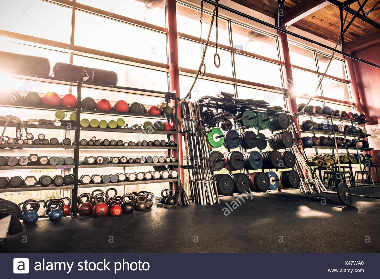 Gym equipment - weights, gym balls, kettle bells - Stock Image