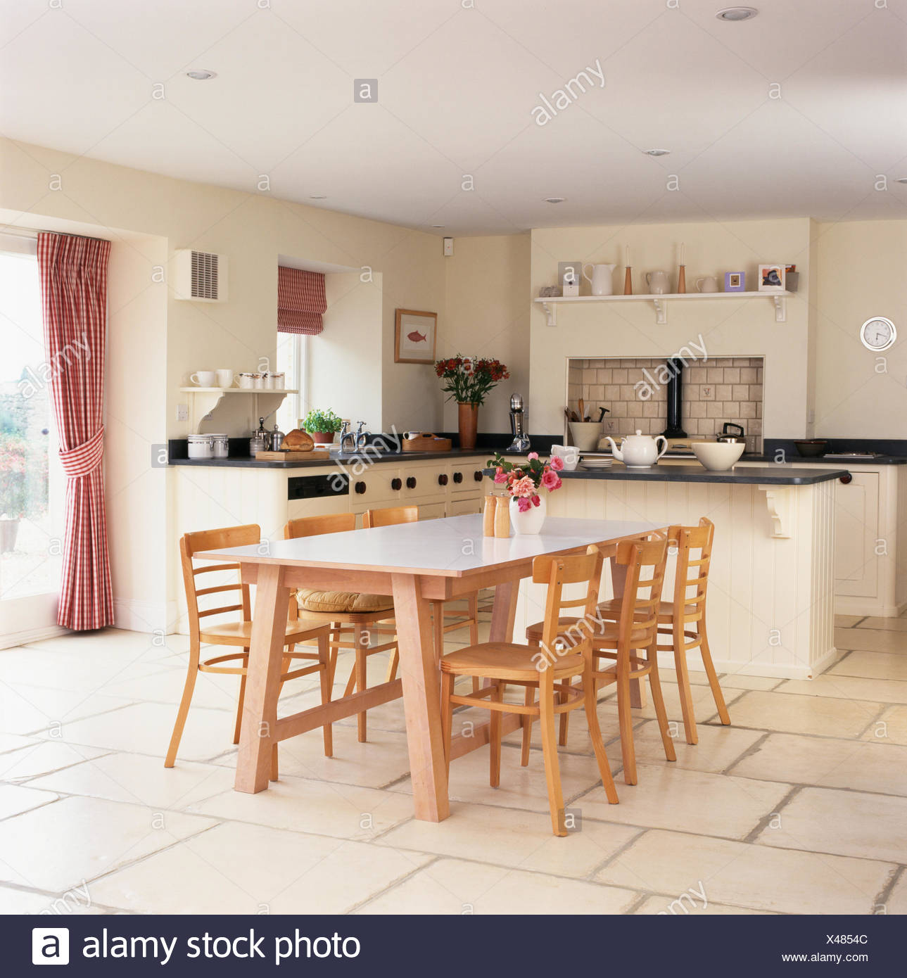 Genial Pale Wood Chairs And Table In Modern Kitchen Dining Room With Limestone  Tiled Floor