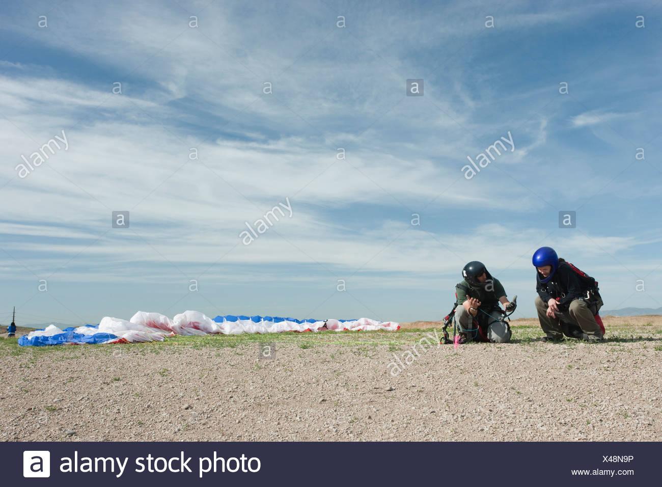 USA, Utah, Lehi, Two paragliders on ground - Stock Image