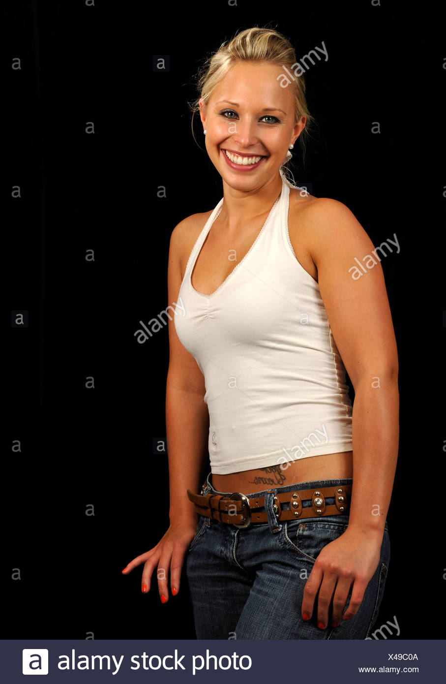 3f78b126f9fd9 Young woman wearing a white tank top Stock Photo  278031498 - Alamy