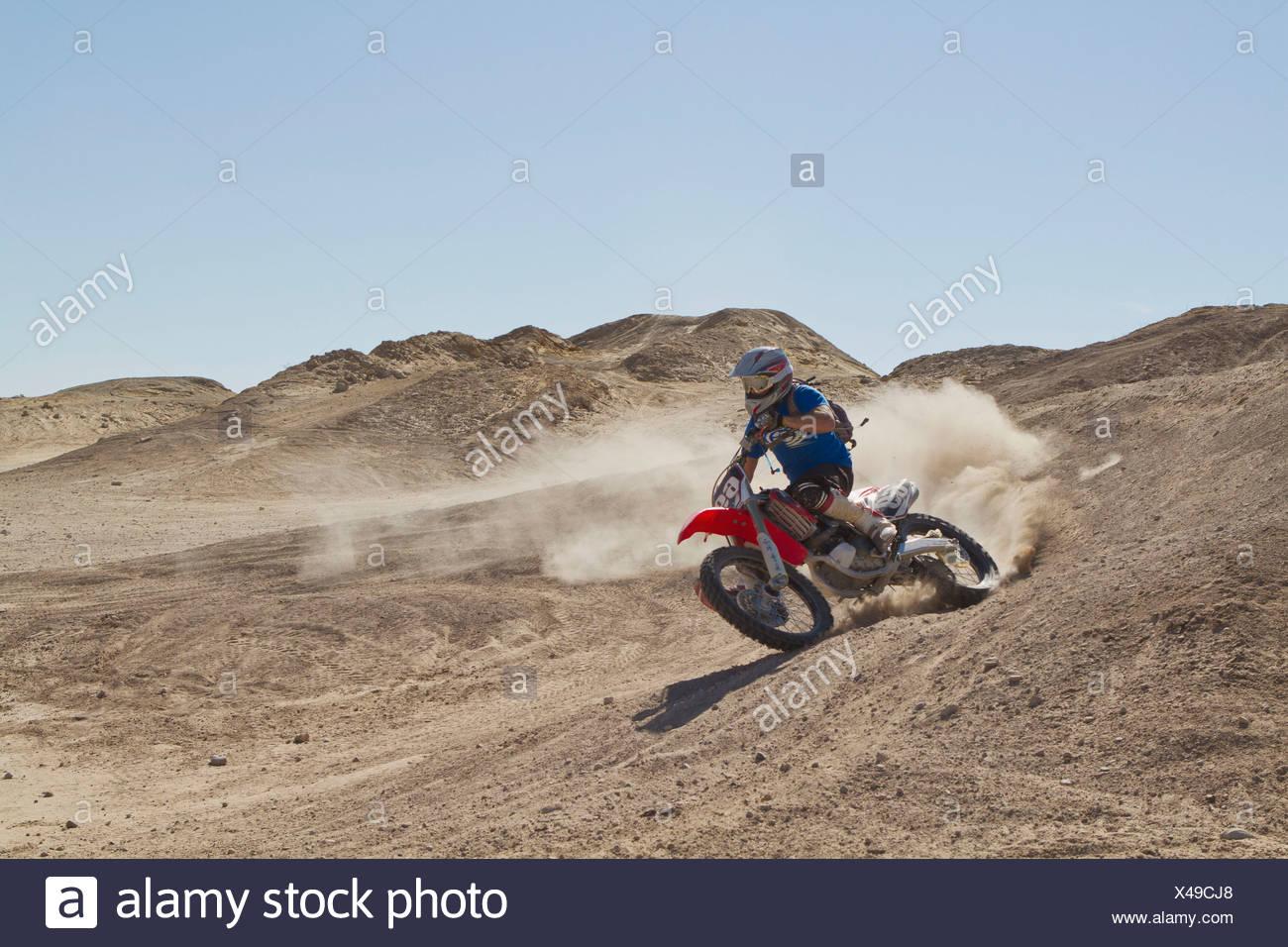 USA, California, Motocrosser performing power slide on Palm Desert - Stock Image