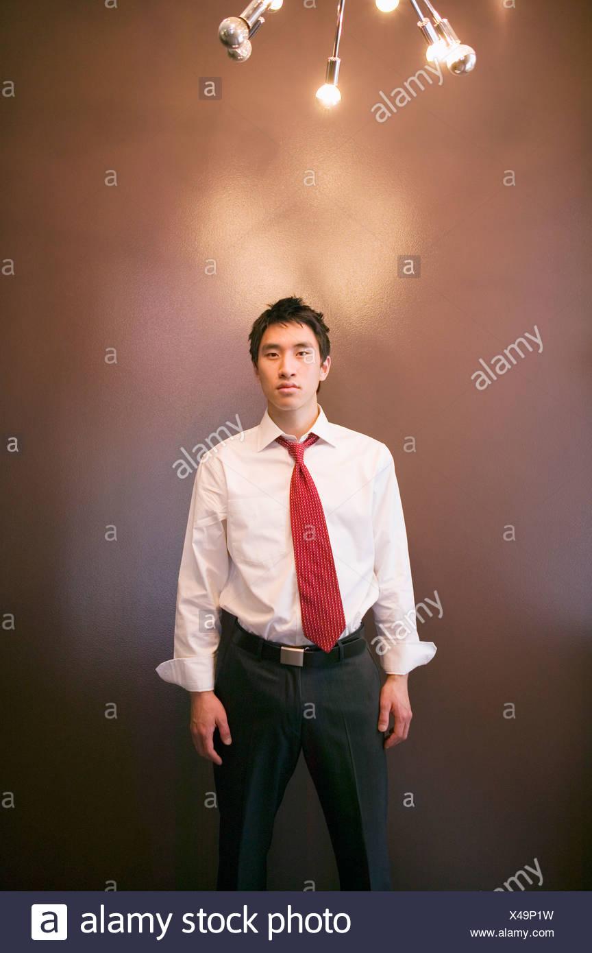 Asian businessman under lighting - Stock Image