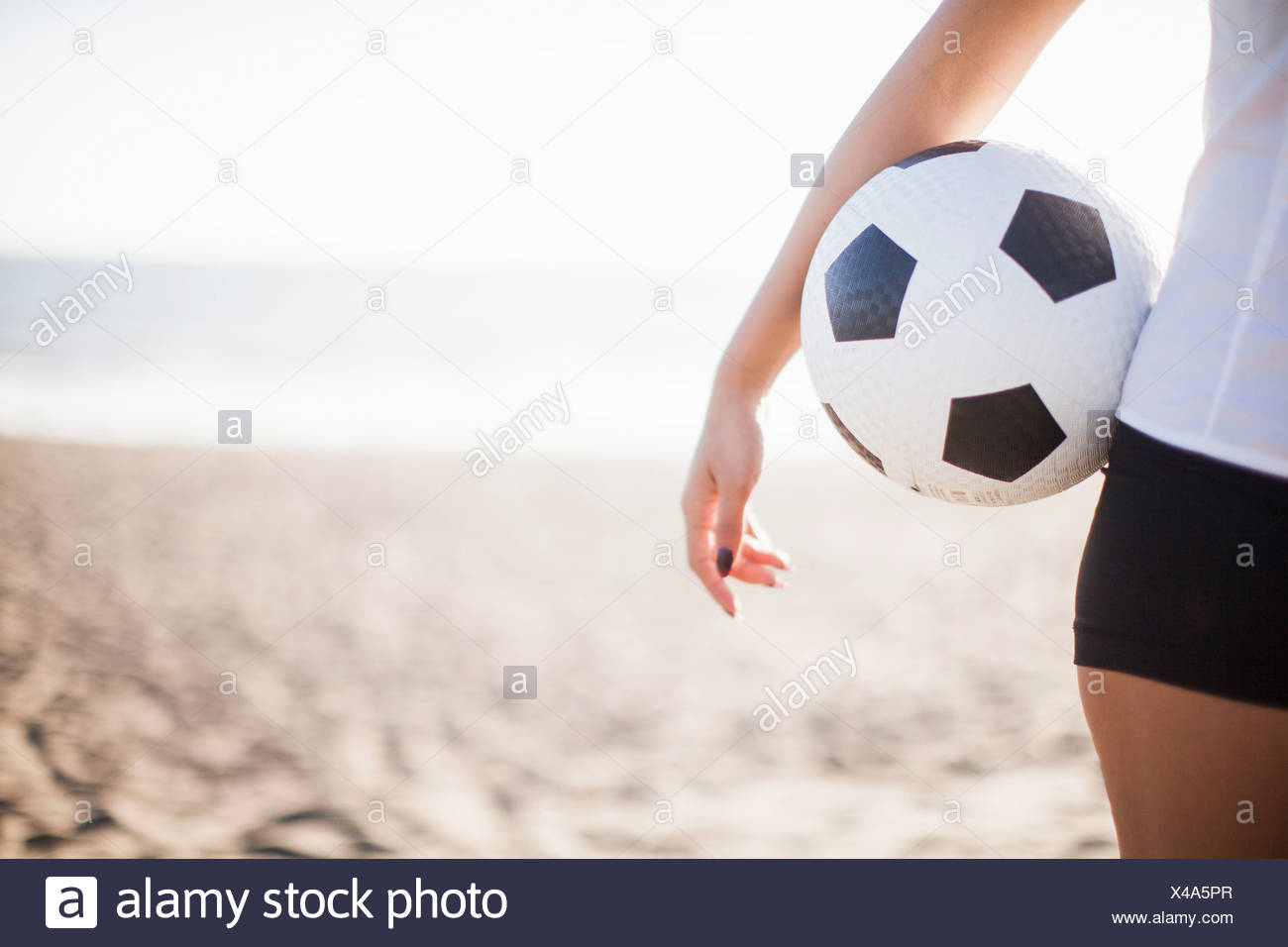 Young woman holding football - Stock Image