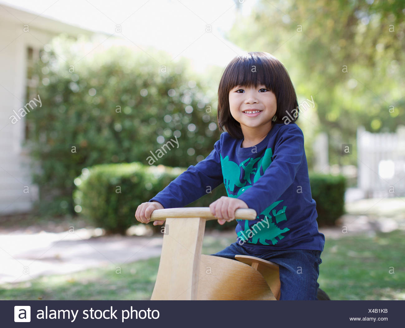 4-5 years,active,asian ethnicity,backyard,boy,boys,california,casual clothing,childhood,color image,day,elementary - Stock Image