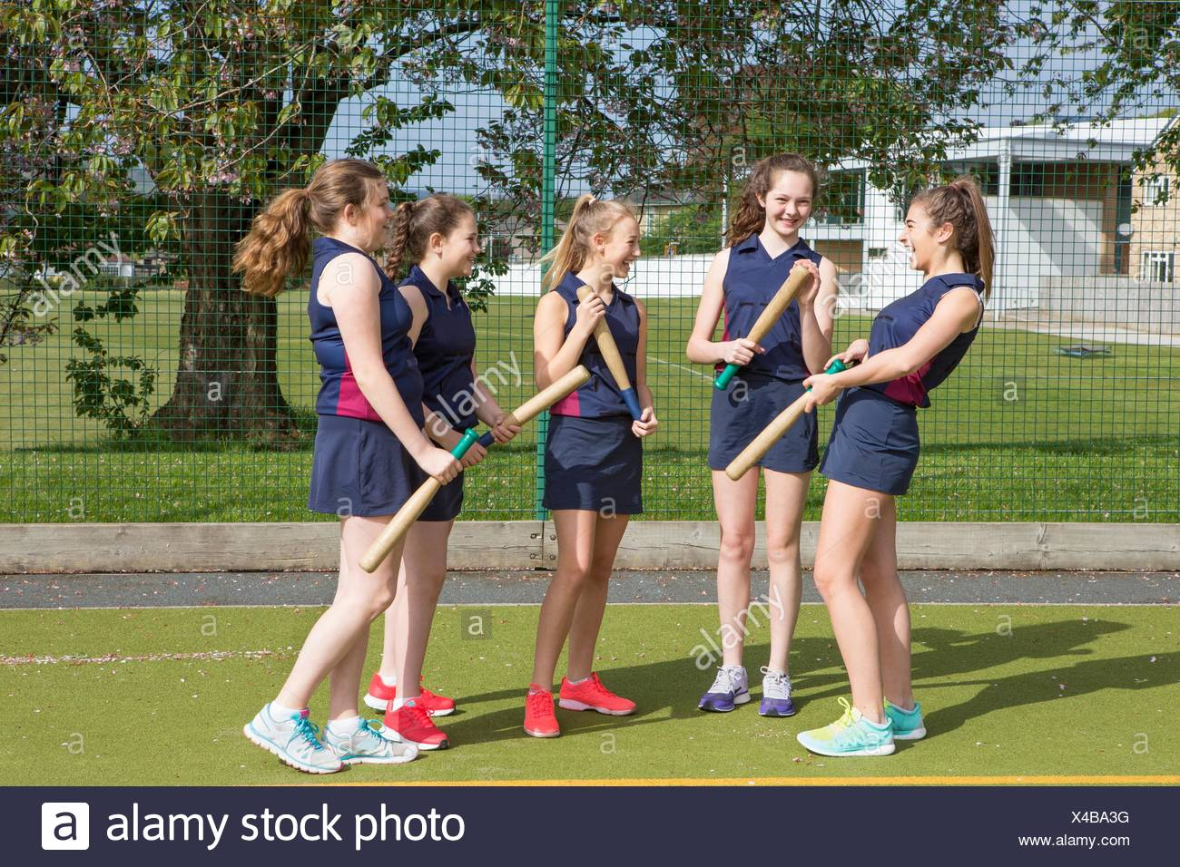 Group of girls with rounders bats - Stock Image