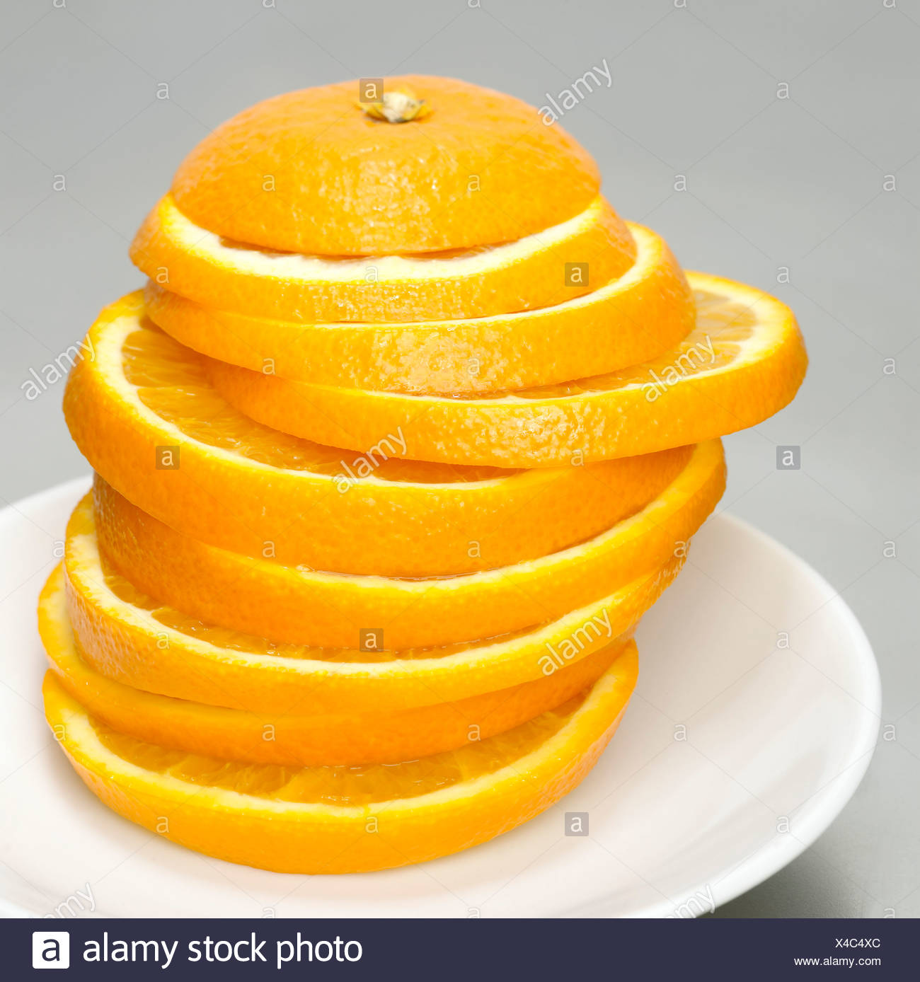 Stacked orange slices, close-up - Stock Image
