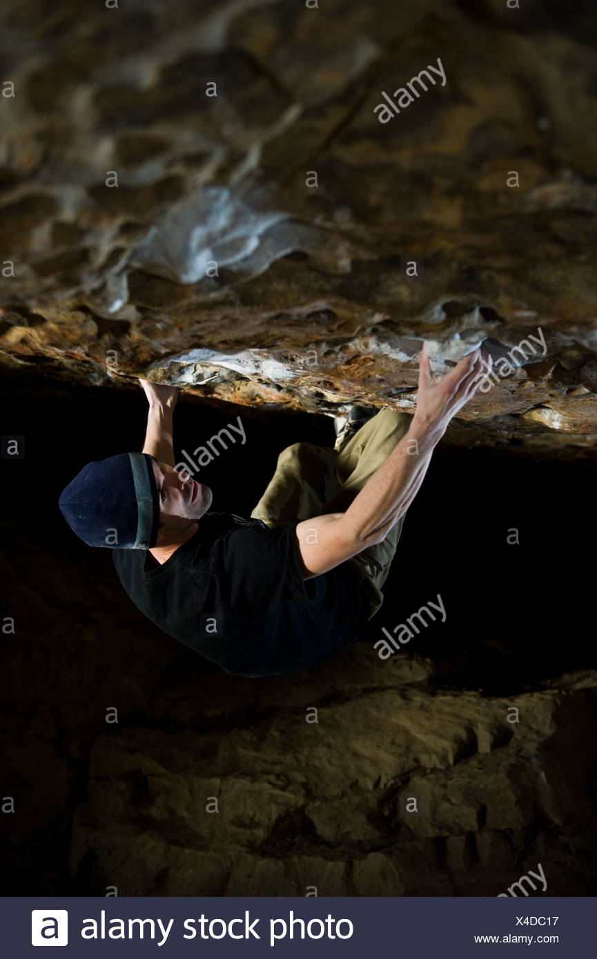 A man bouldering on steep rock - Stock Image