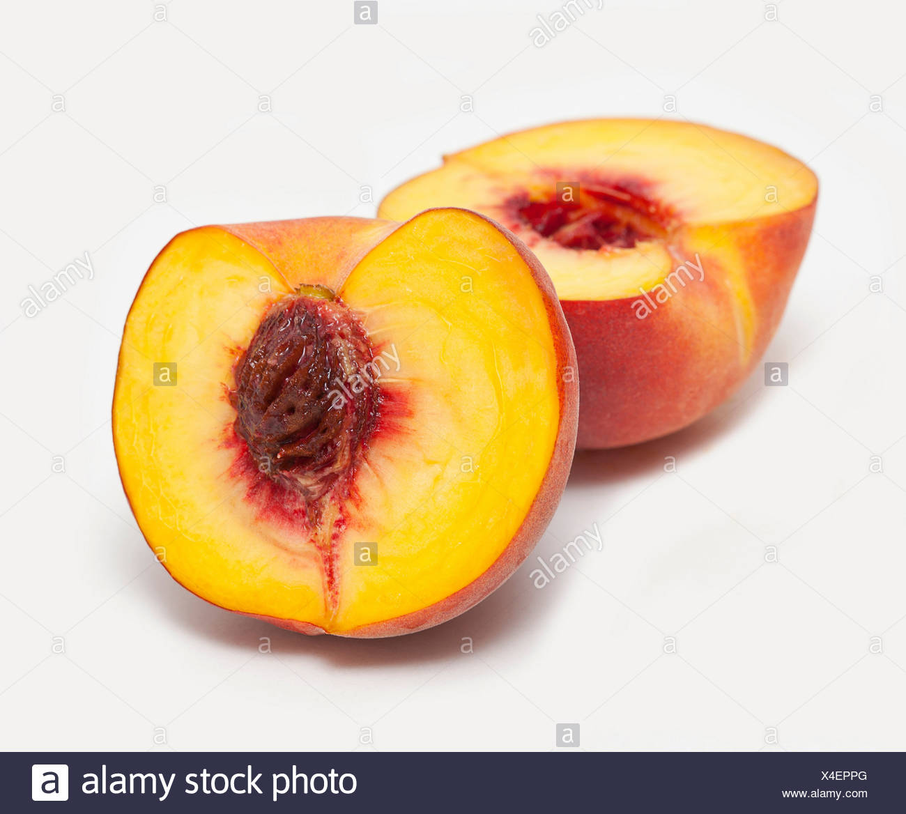Peach cut in half - Stock Image