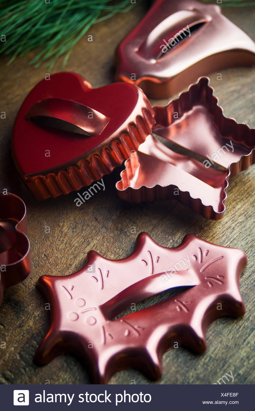 A Close Up of Vintage Copper Holiday Cookie Cutters - Stock Image