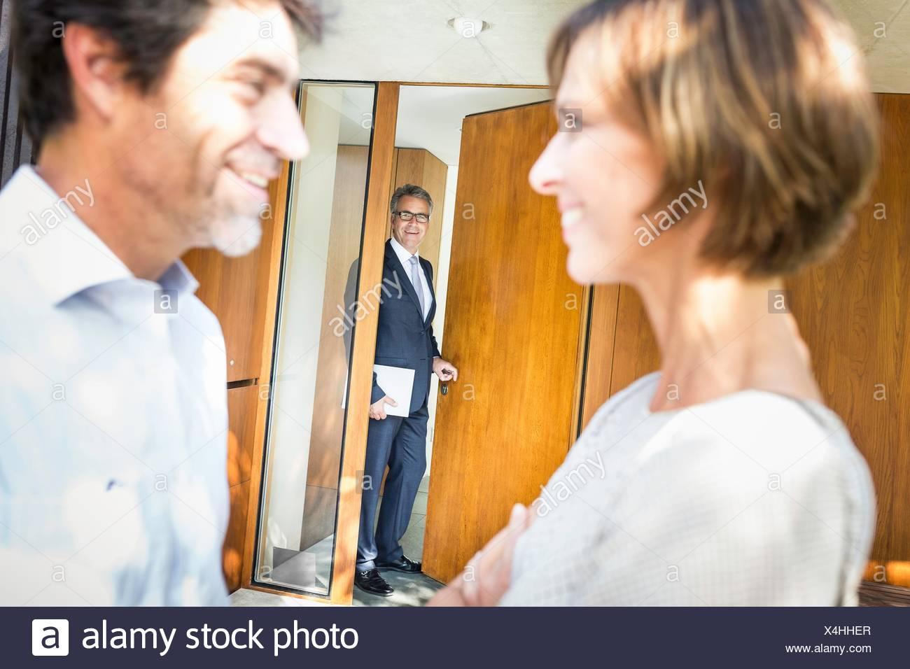 Mature couple deciding on new house - Stock Image