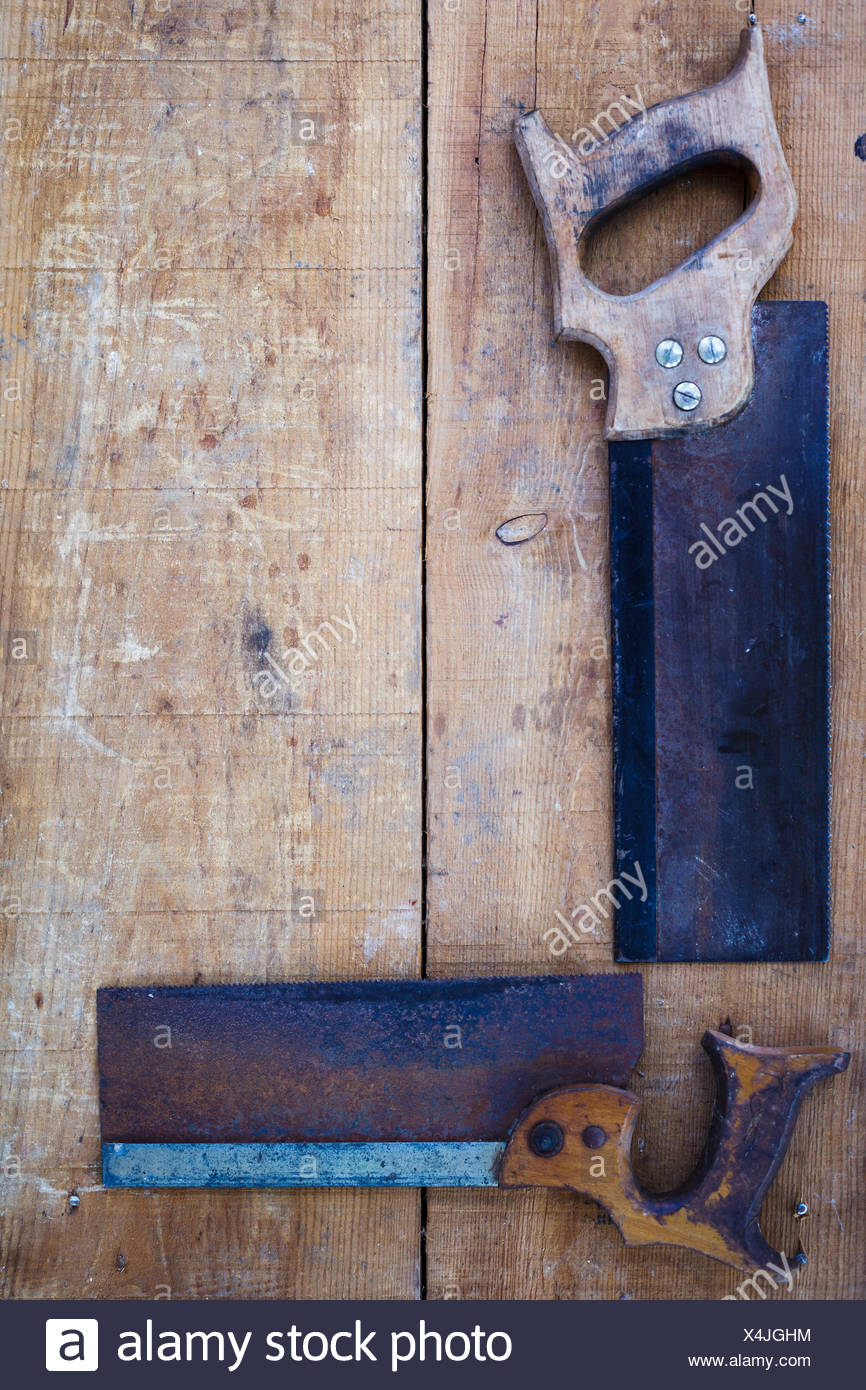 High Angle View Of Hand Saws On Wood - Stock Image