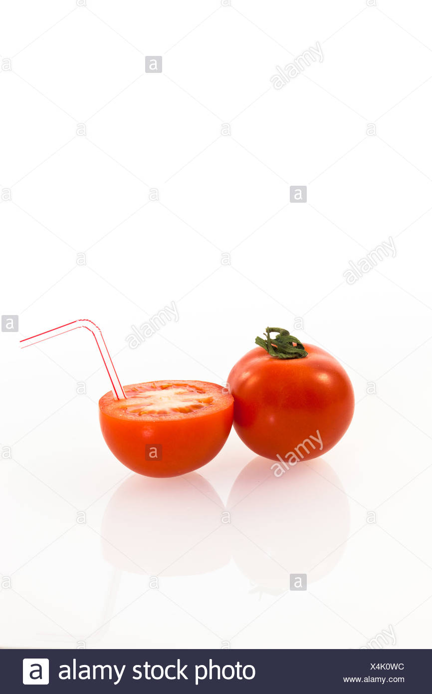 Tomatoes, tomato with a drinking straw as a soft drink - Stock Image