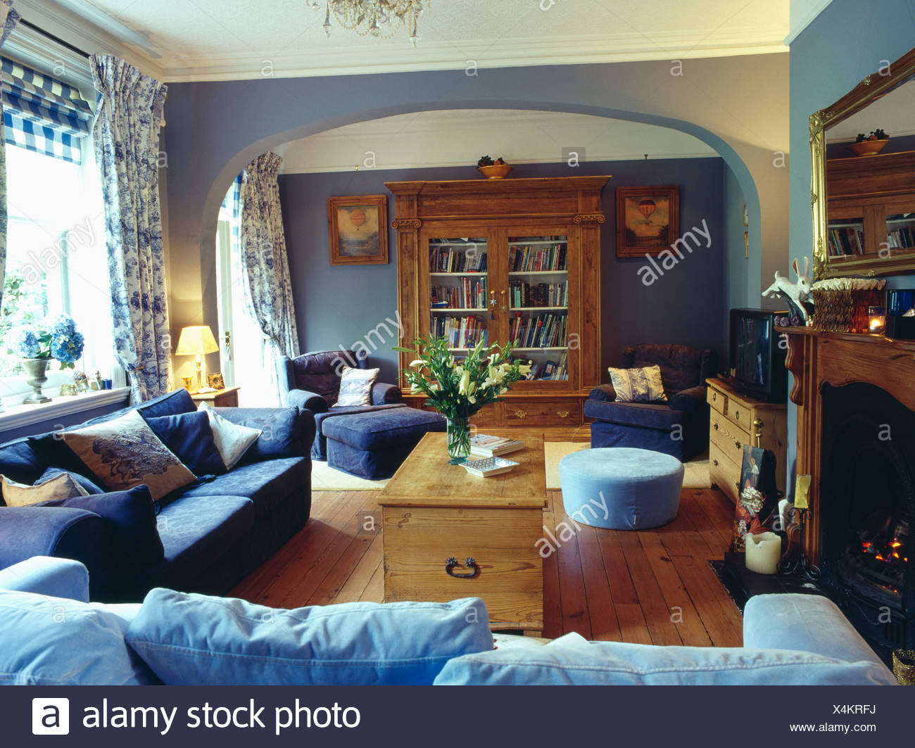 dark blue living room cozy pale blue and dark sofas pine chest in pale living room with floral curtains wooden floor large cupboard