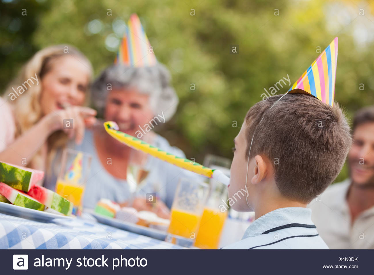 Cheerful son celebrating his birthday with his family - Stock Image