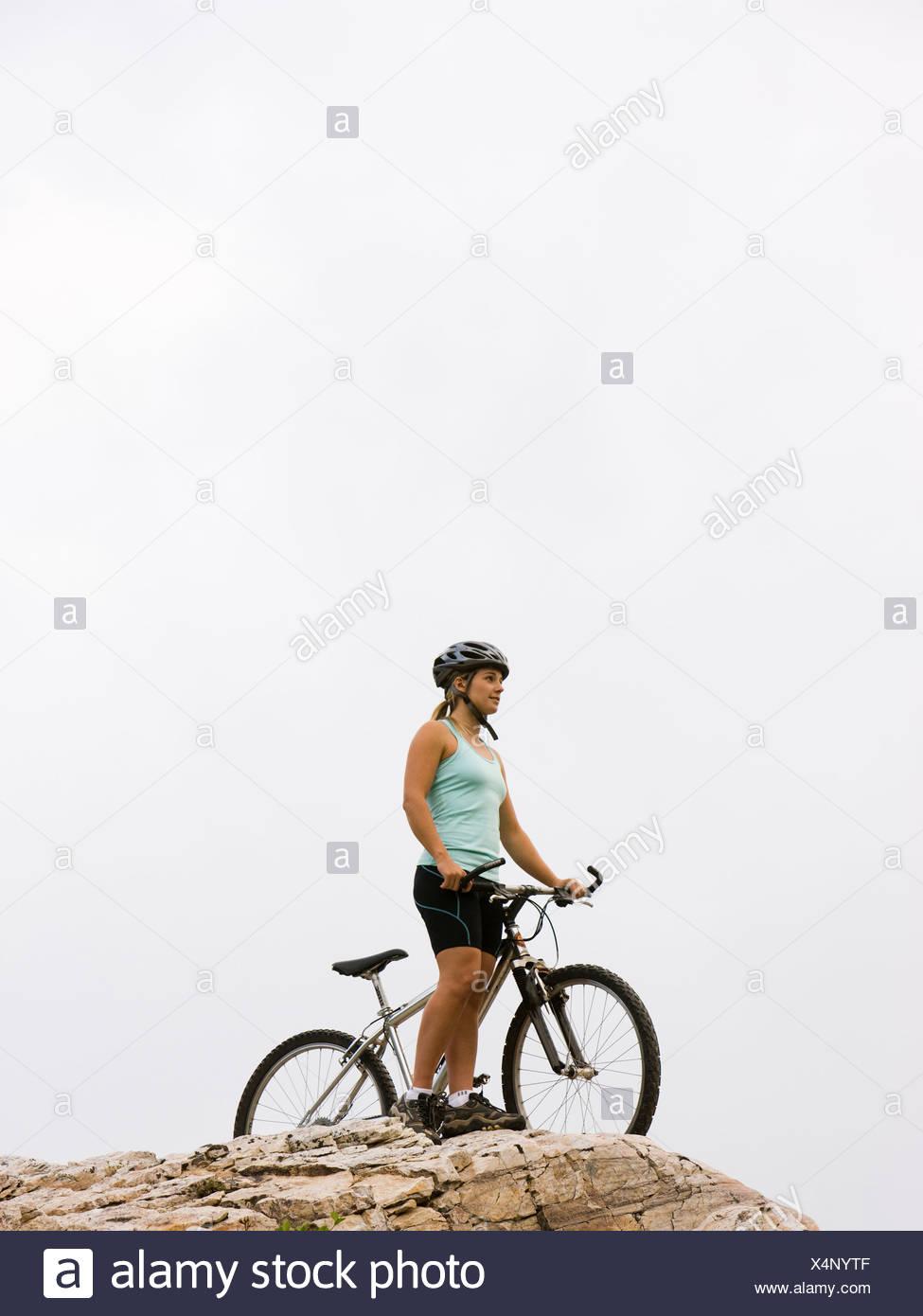 mountain biker on a rocky ridge - Stock Image