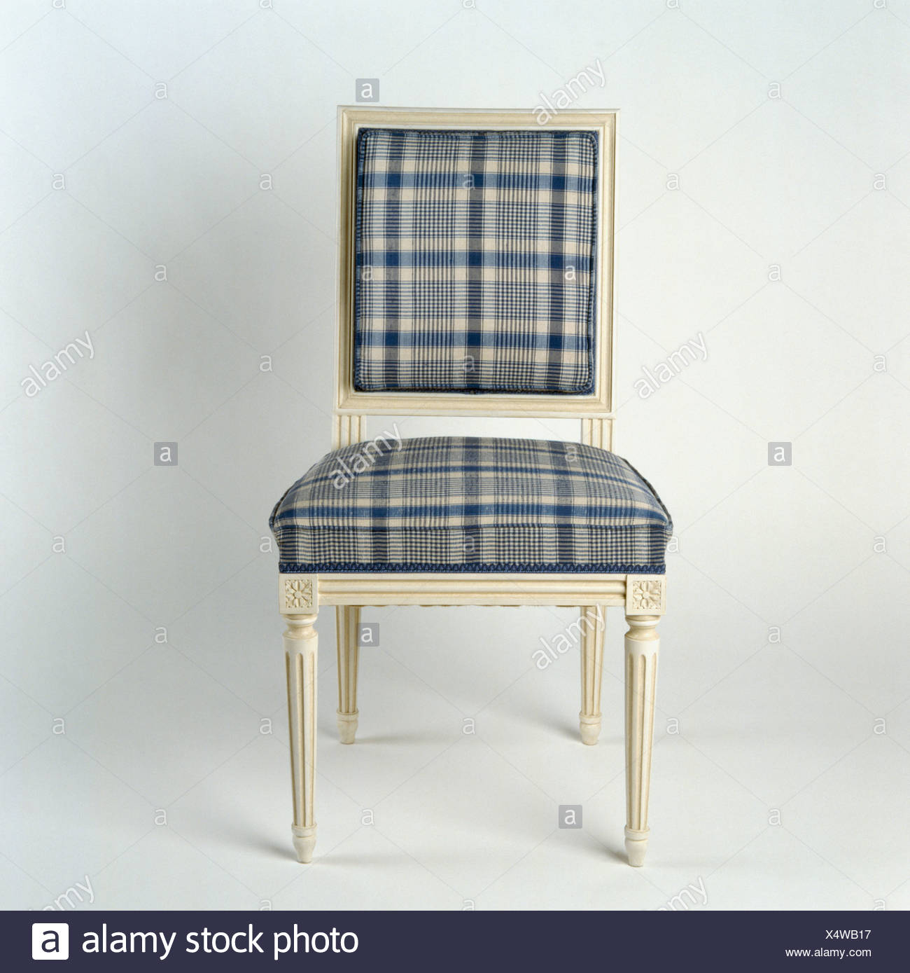 Close Up Of Cream Painted Dining Chair Upholstered In Blue+gray Plaid Fabric