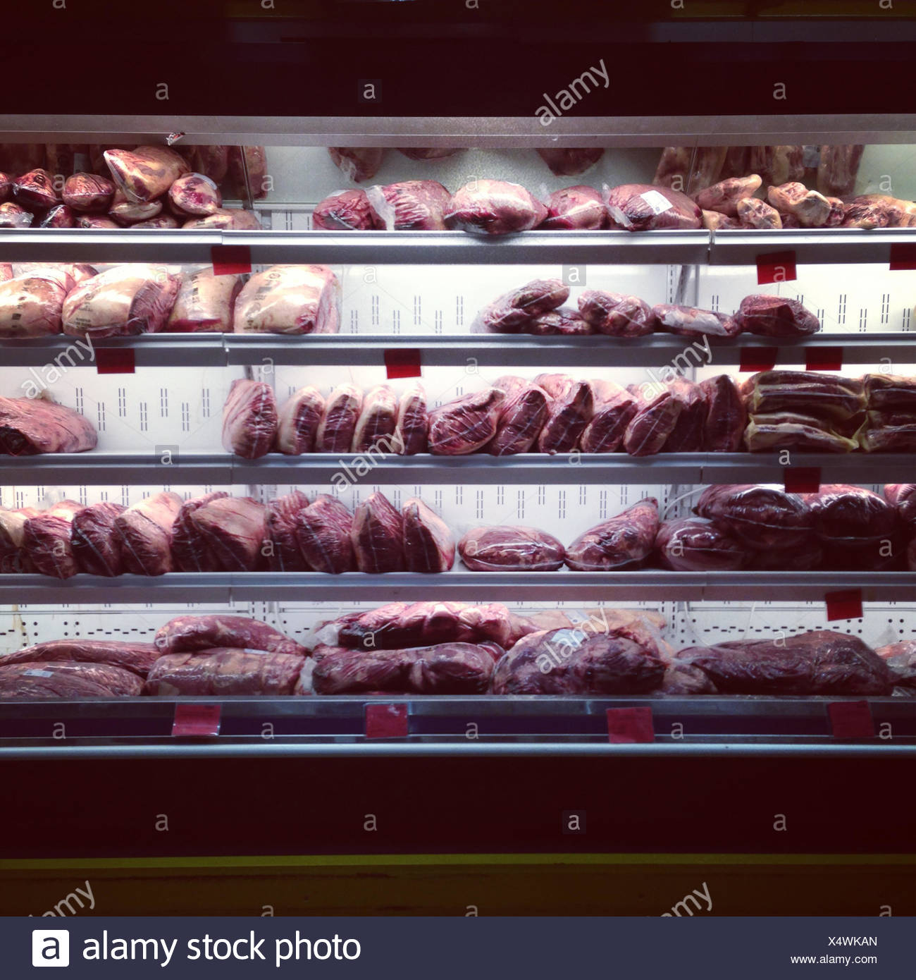 Close-up of meat in a supermarket fridge - Stock Image